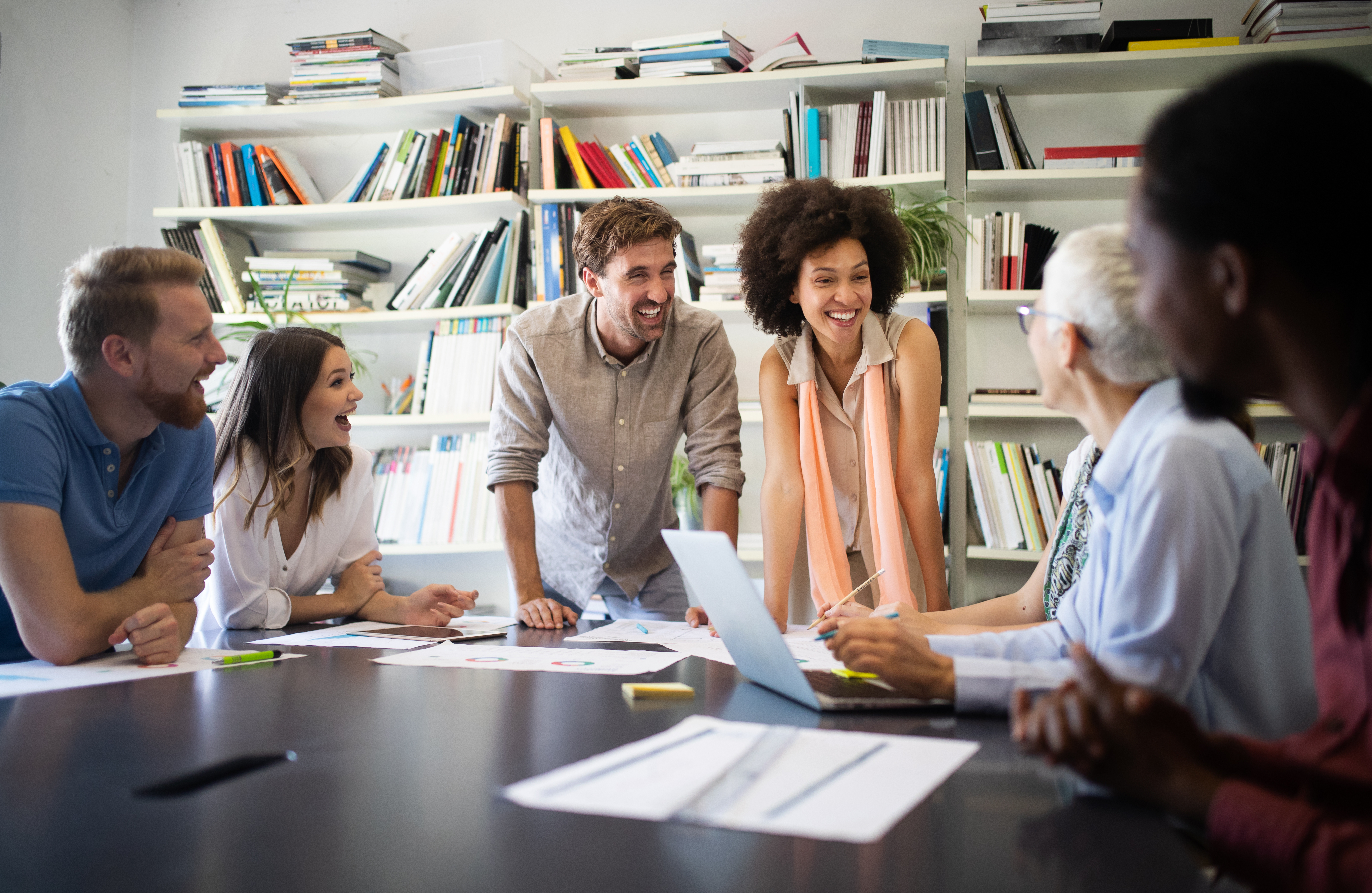 Cheerful coworkers, business people in office during company meeting